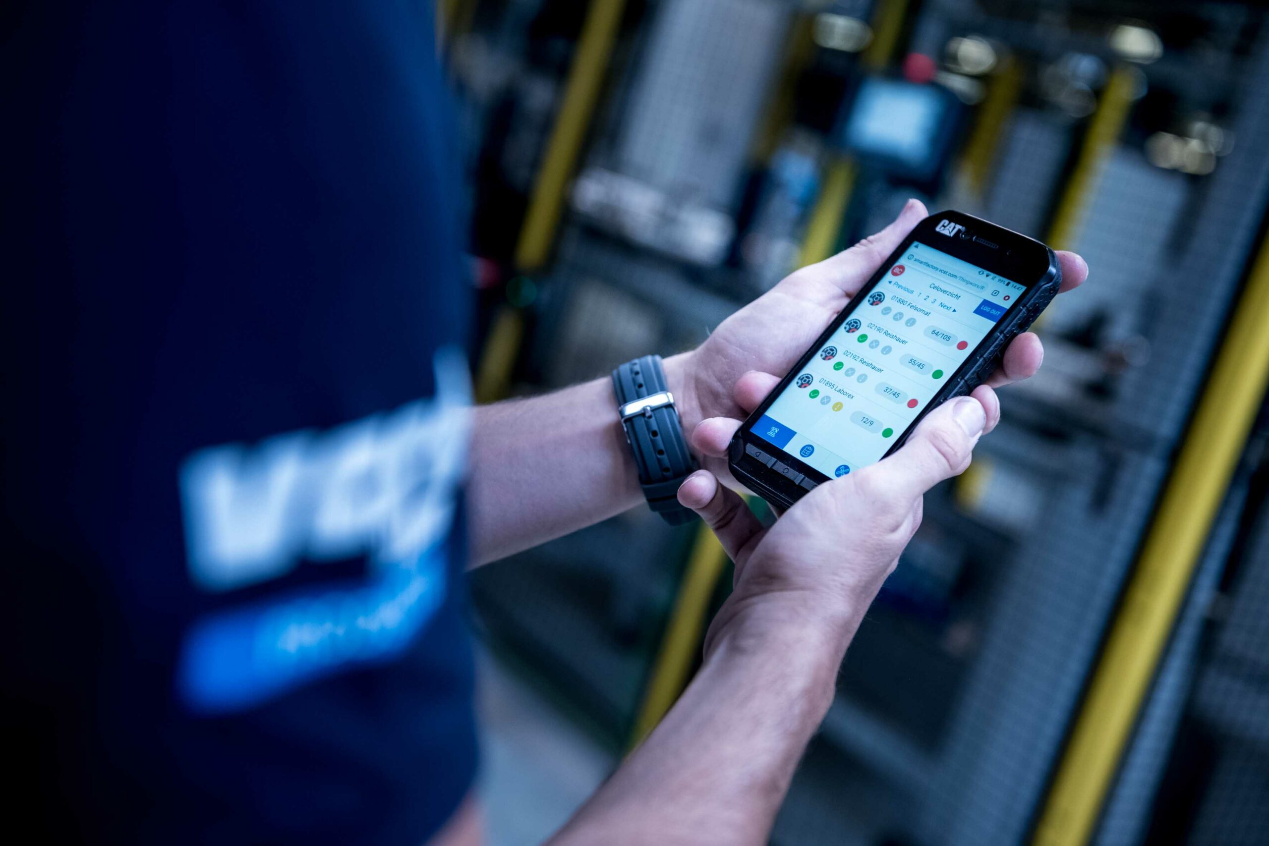 Employee analysing on his mobile smart factory app